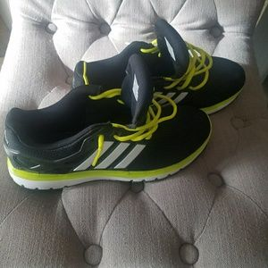 Adidas sneakers. Green and black tennis shoes